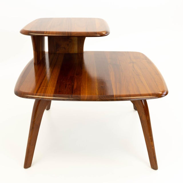 Walnut mid century corner side end table. Made in the mid 20th century.