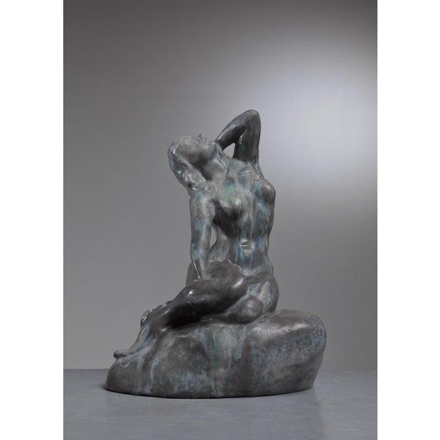 A classic ceramic mermaid sculpture by Danish ceramist Jens Pedersen. The ceramic has a beautiful green, bronze like...