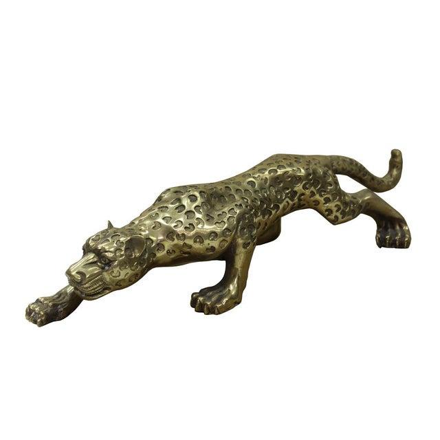 "Detail handmade metal golden color jaguar leopard animal figure statue. Dimensions: 14.75"" x 4.25""x h3.5"" Origin: China..."