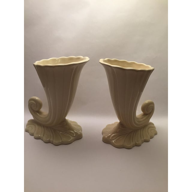 Lovely pair of ivory vases - great for accessorizing or flowers! One bottom is glazed, the other is not. Marked.