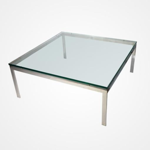 High polish stainless steel coffee table with 3/4 inch glass top. Seamless construction. USA, c. 1958.