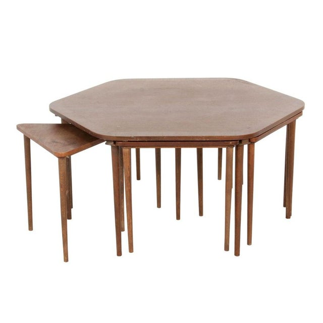 Rare vintage mid-century Danish modern teak or rosewood coffee table with 6 Nesting Tables. This coffee table is made of...
