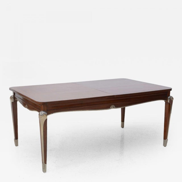 The rectangular top with checkerboard veneer inset around central banding, the frieze with scrolling and silvered bronze...