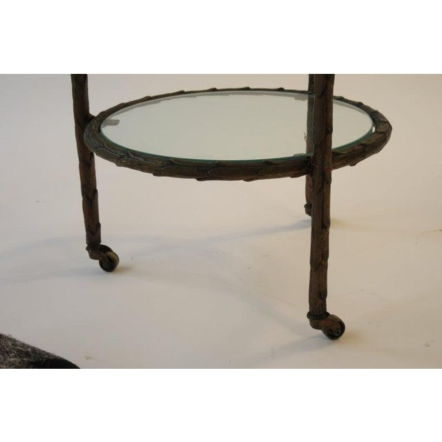 1950s Baguès bronze circular nesting tables. All three tables sit together to form one table. Unfortunately our pictures...