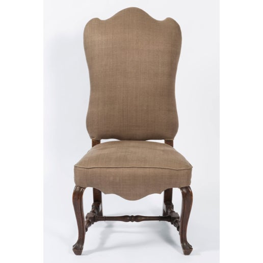 19th century pair of walnut Italian side chairs with shaped back. The legs are of a scroll design and the seat is shaped...