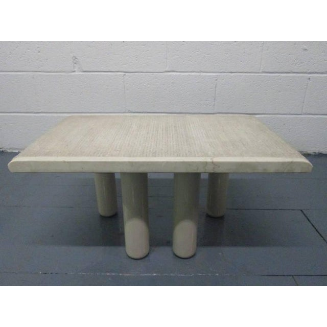 Pair of Italian marble end tables with lacquered metal legs.