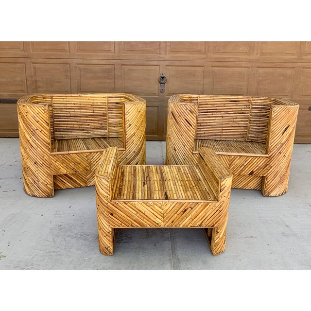 Stunning stacked bamboo club chairs and ottoman One previous owner, very well cared for. Heavy construction and quality...