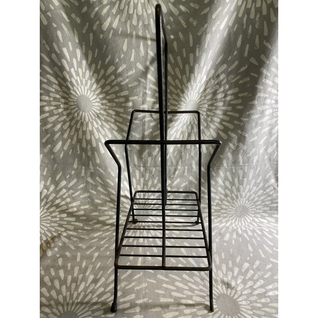 Vintage midcentury modern black metal wire record holder. This could also be used to hold magazines and book (or really...