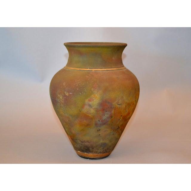 Signed American Raku Mid-Century Modern inside glazed handcrafted beige, blue, gold and brown vase, vessel or urn. The...