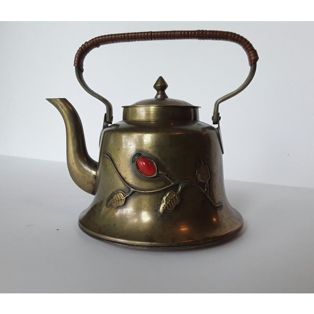 Lovely little vintage teapot. Chinese with a raised foliate design with a stone accent on both sides. Made of brass the...