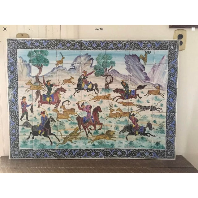 Magnificent hand painted ceramic Persian tiles. 35 individual tiles combined to form a hunting scene and mounted on wood....