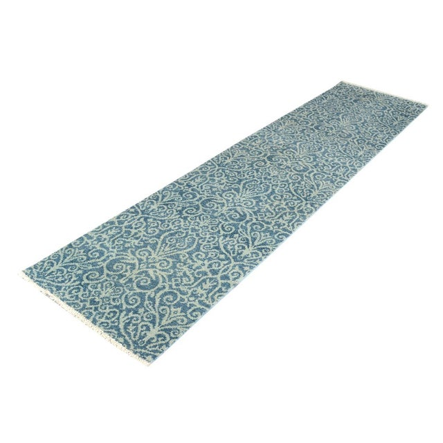 Modern hand knotted runner made with luxurious wool is a refreshing addition to your décor. Mesmerizing Intricacy and...