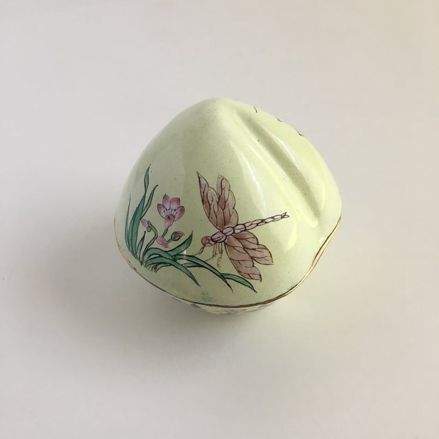 A whimsical little vintage hand painted enamel Trinket Box decorated with dragonflies, butterfly's, and grasshoppers. This...