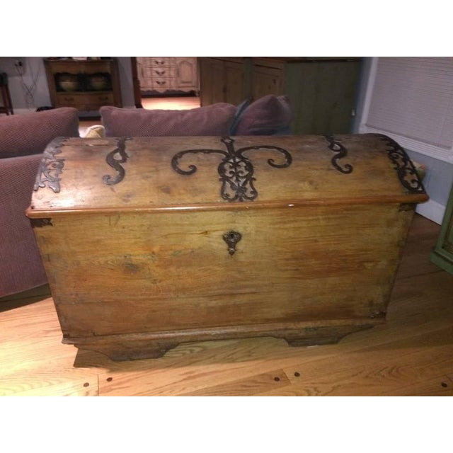 Large dome Topped Wooden Blanket chest or Trunk with ornate ironwork. Great for storing blankets or linens. CONDITION...