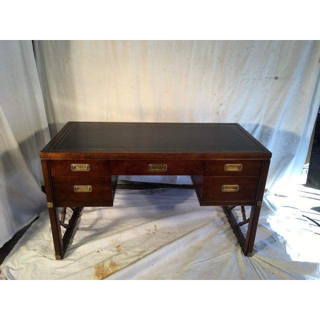 Handsome , oak campaign style desk, with brass hardware and black leather top. Faux bamboo fretwork completes the look....