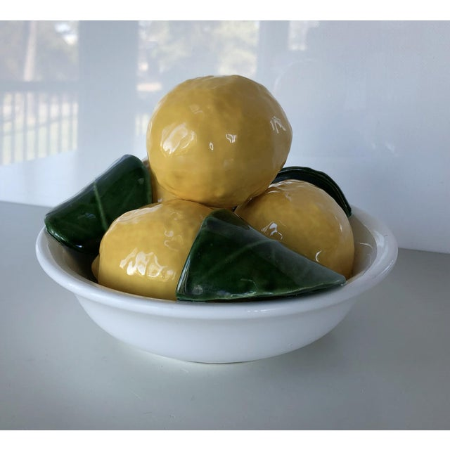 """This beautiful ceramic bowl of lemons will brighten any decor! This trompe l'oeil bowl is marked """"1577, Bertinazzo Italy""""...."""