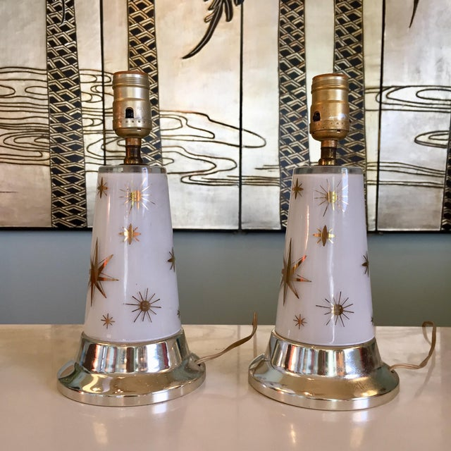 A pair of 1950s glass lamps with celestial design. A mid-century modern staple for any home. Lamps/ wiring are in original...