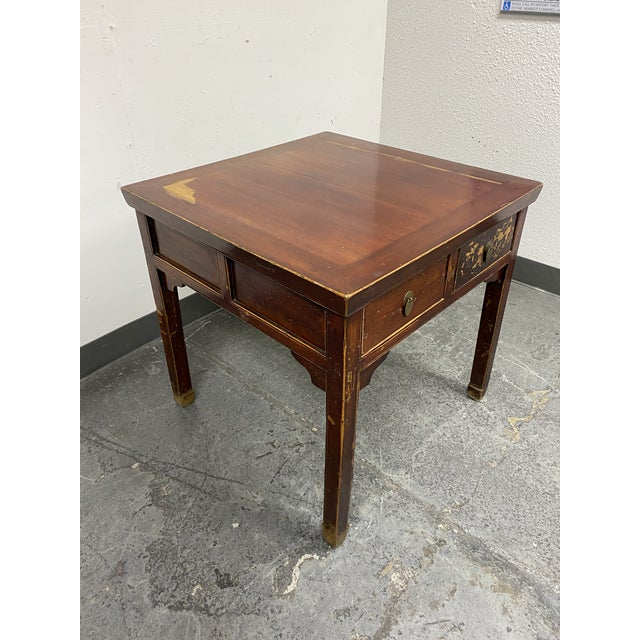 Design Plus Gallery presents a Mid 20th Century Chinese Game Table. Visible wear through out the finish on the elm...