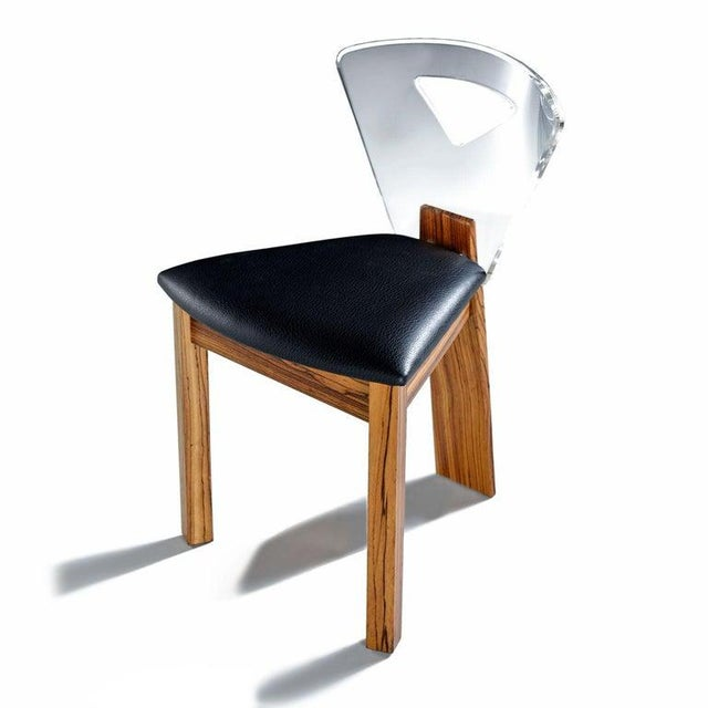 Every aspect of this set of chairs is exquisite. The chairs are unmarked and the unique construction hints that these may...