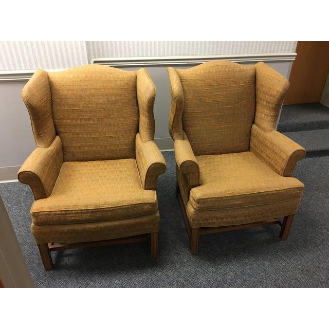 Pair of elegant Chippendale design wing chairs covered in golden orange tweedy fabric (original)