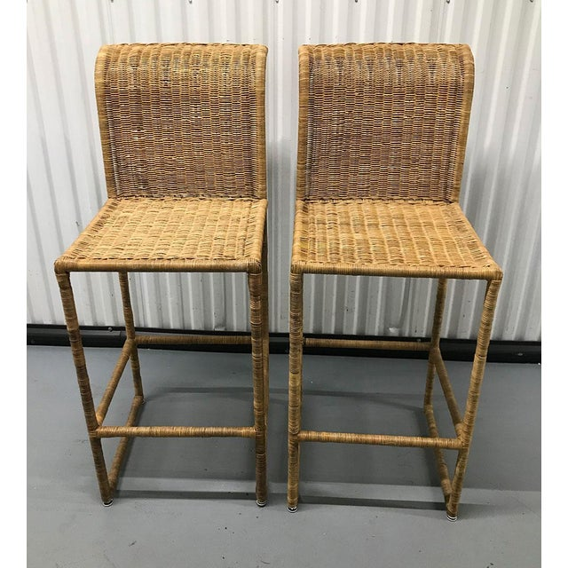 Stylish, clean-lined pair of rattan bar stools, c.1970s. Very clean-lined, modern form with a curve at the back top....