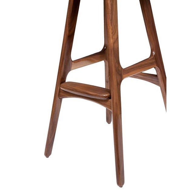 Boyd counter stool shown in solid walnut with black leather seat. Custom orders have a lead time of 2-8 weeks FOB NYC....