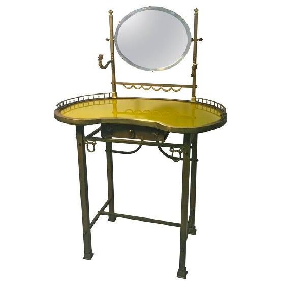 An exquisite 19th century French, bronze vanity with hand-painted yellow glass top and brass accents. Highly decorative...