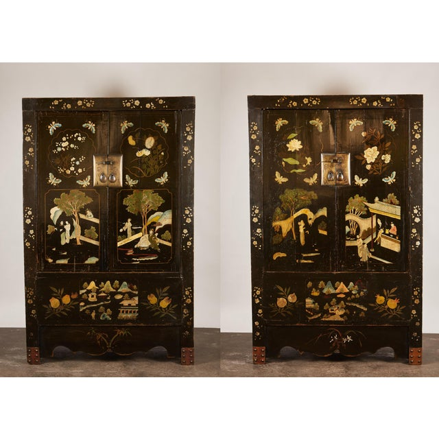 A rare pair of 18th century Chinese cabinets made from traditional construction techniques offering the interior to...