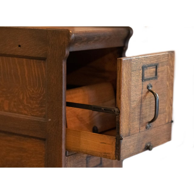 This beautifully preserved antique wooden filing cabinet is estimated to have been built in the 1910's or 1920's. It...