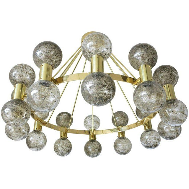 Limited edition Italian modern Murano chandelier shown in smoky Murano bollicine glass globes and polished brass finish by...