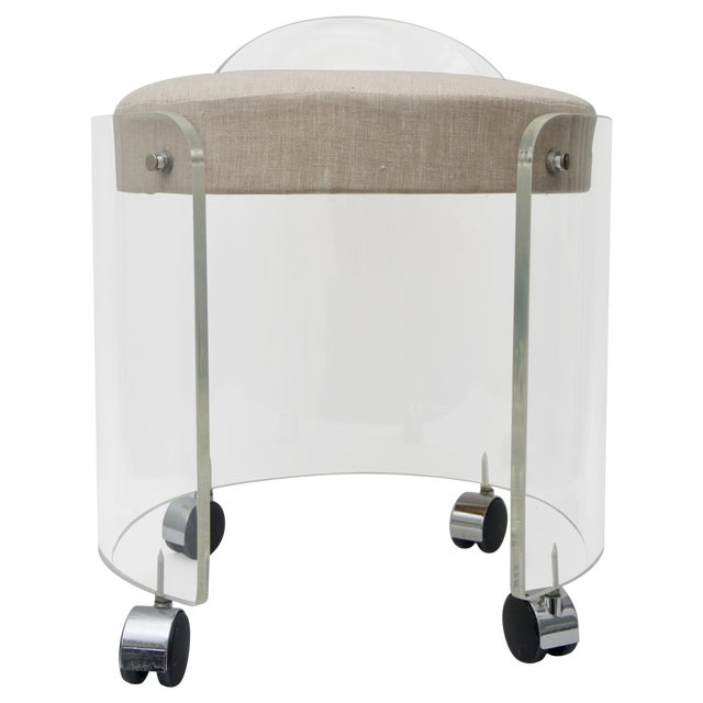 This stylish Lucite vanity chair is by Charles Hollis Jones and dates to the 1970s and has been professionally polished...