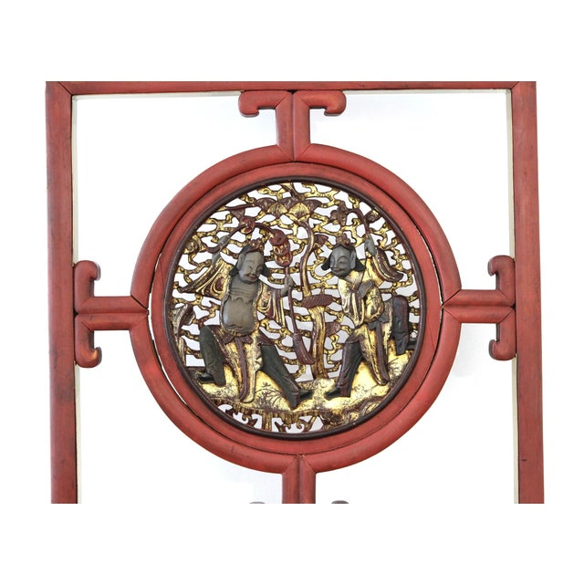 Asian red lacquer and parcel gilt screen element mounted with metal embellishments and mounted on a metal stand,...