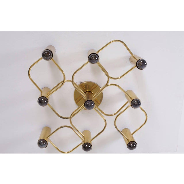 Stunning nine-light flush mount, wall or ceiling lamp. It can be used as wall or ceiling lamp and is in very good...