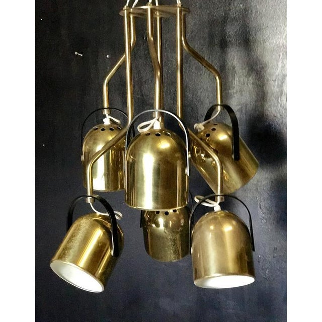 Italian 1970s brass pendant light Six arms, six lights.