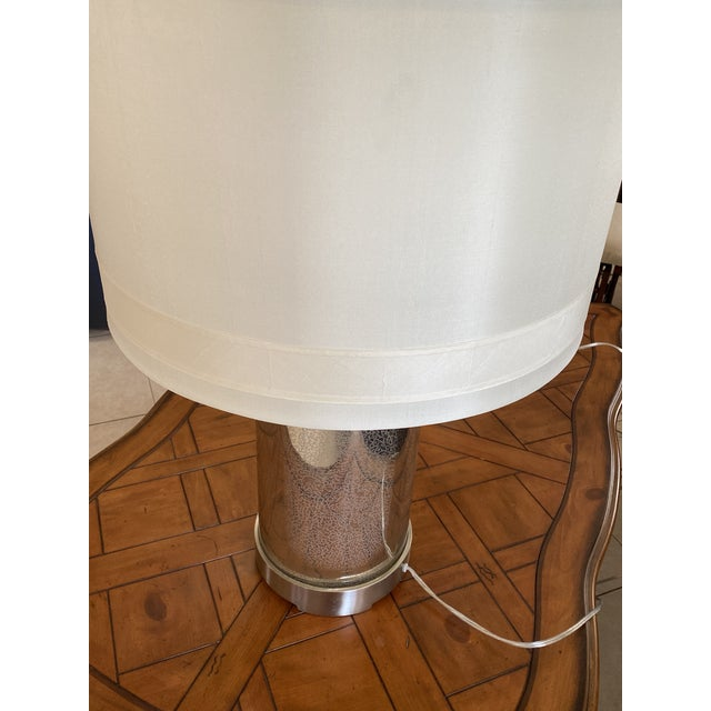 Pair of Global Views Lighthouse Lamps with shades. Beautiful hand blown antiqued mercury glass. One shade has a small...