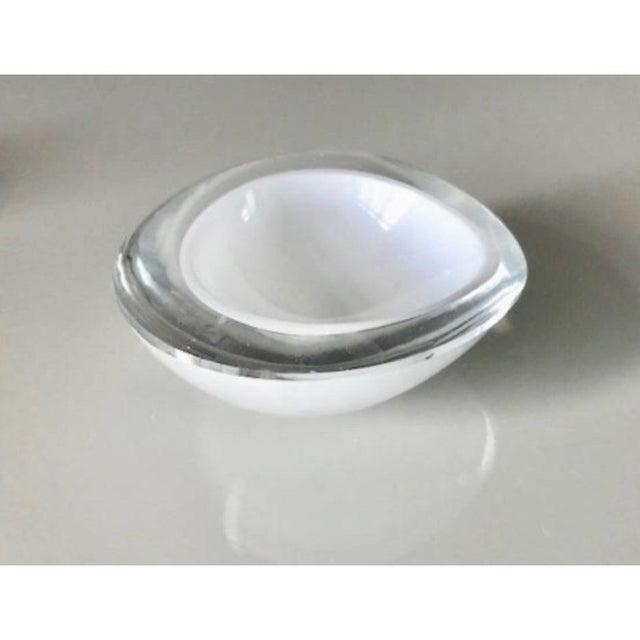 A set of 3 Kaj Franck iconic chestnut bowls. Designed for Nuutajarvi Notsjo in Finland c. 1950s. Beautiful thick white...