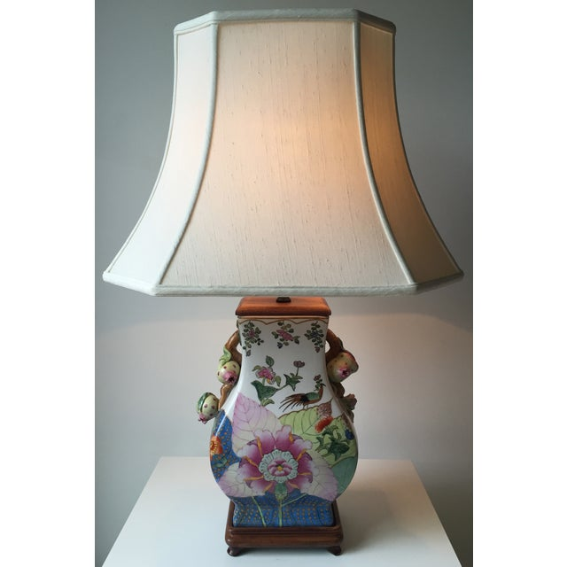 Stunningly beautiful polychrome vintage Chinese porcelain lamp with wood pedestal base, cord switch, harp, finial and...
