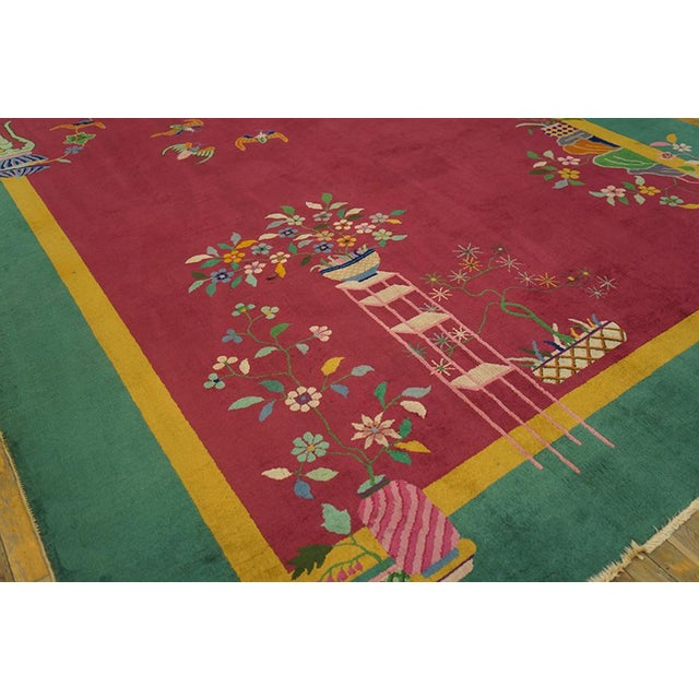 """This is a Chinese art wool rug from China 1920. The size is 8'9""""x11'4"""". The colors are pink, cream, turquoise, blue, pink,..."""