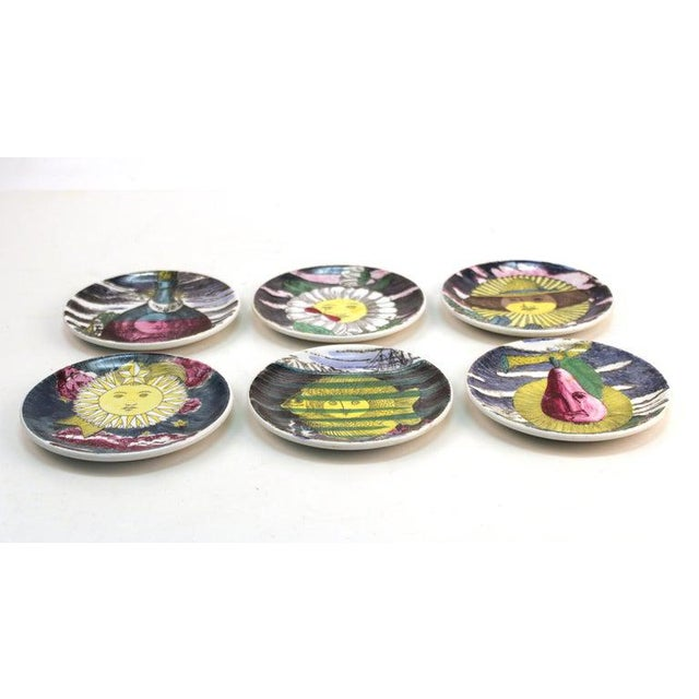 rare Italian mid century modern set of 6 coasters designed by Piero Fornasetti in the 1960's. The set comes with its...