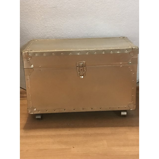 Gold metal rolling trunk or chest. Hollywood regency style. Made in the 1950s.