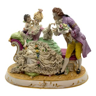 1900's Porcelain Figurine of Lady on Chaise With Man and Cherub For Sale