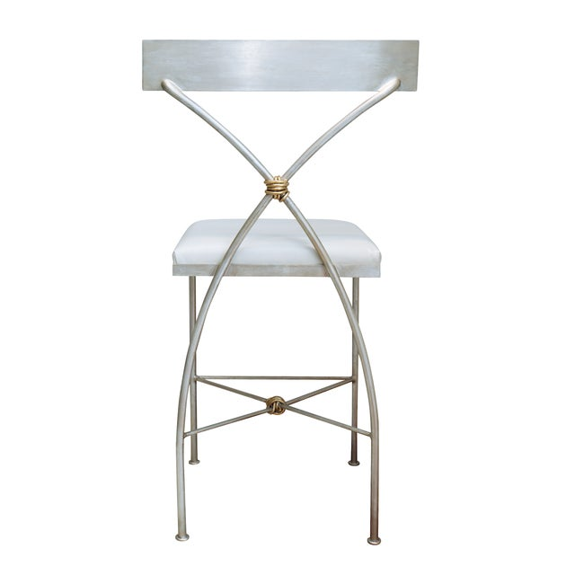 The Ivey Counter Stool has elegantly sloping legs and a slightly curved back. The stool is constructed of solid steel and...