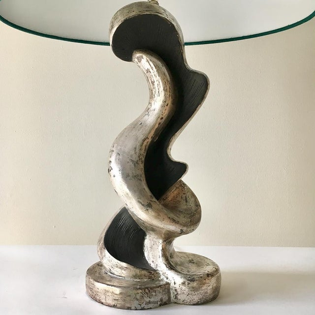 A Pair of 1950s Biomorphic Shaped Plaster Table Lamps Painted in Silver and Black NB: These items are subject to a further...