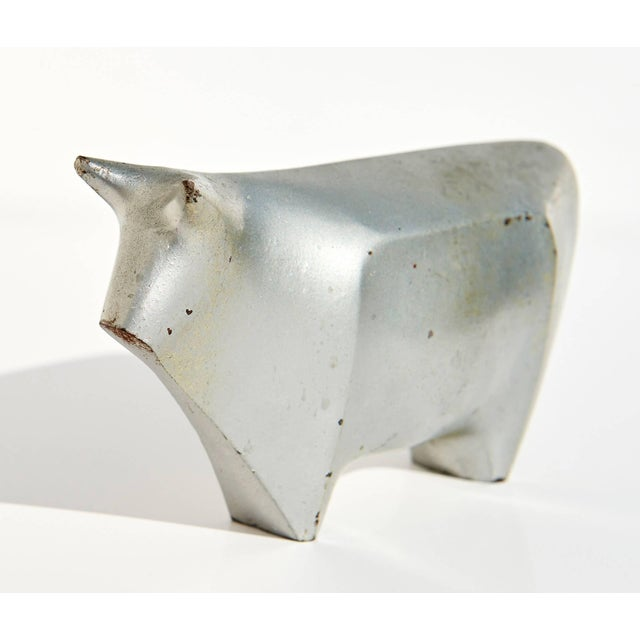 This enameled iron sculpture of a bull by Hiramatsu Koshun has a substantial feel, and a lovely patina which contrasts...