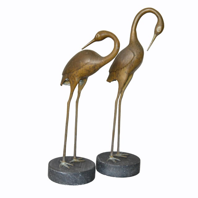 A pair of vintage bronze Asian inspired crane sculptures on black-gray marble bases. No markings. Can be used for indoors...