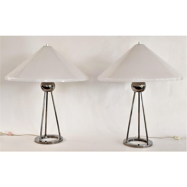 This is a pair of Van Nessen chrome and white lucite table lamps. The 1970s pieces give off a lovely ambient light.