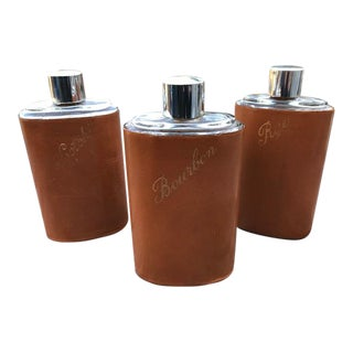Early 20th Century Mid-Century Whiskey Trinity Leather/Glass/Chrome Flasks - Set of 3 For Sale