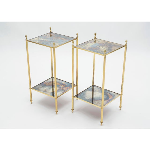 This pair of two-tier end tables by French design house Maison Jansen was created with solid brass, typical french...
