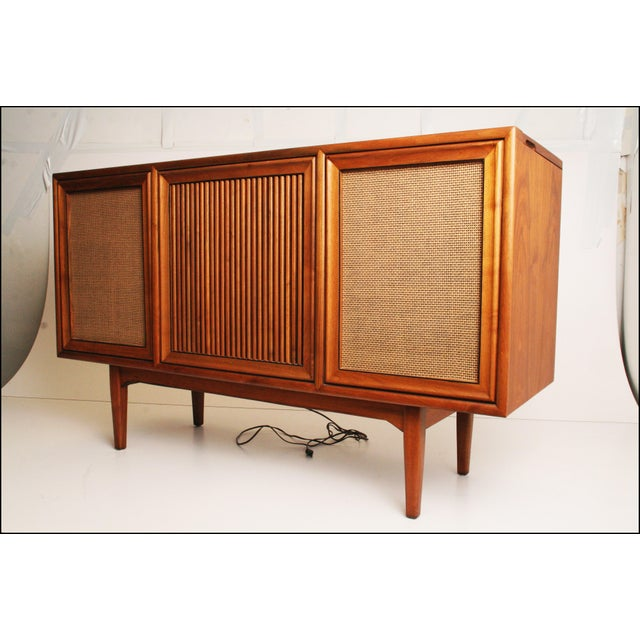 Vintage 1960s record console. Danish Modern streamlined style. Solid hardwood construction. Piece is very heavy. Piece is...