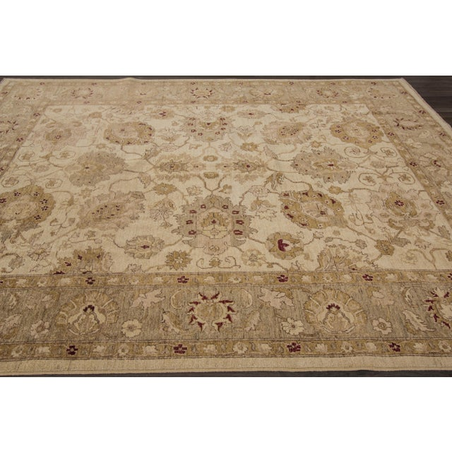 This beautiful hand-knotted Peshawar rug has a great floral design with magnificent detailing. This piece will make your...